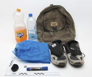 A backpack, pair of trainers, water bottle, Fanta bottle, pen and coins