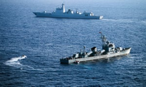 Crew members of China's South Sea Fleet taking part in a drill in the Xisha Islands, or the Paracel Islands in the South China Sea.