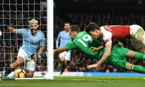 Agüero looks on as the ball trickles over the line for his third goal.
