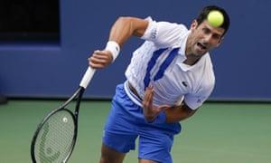 Novak Djokovic, of Serbia, serves to Pablo Carreno Busta, of Spain.