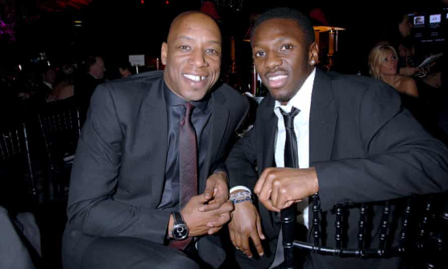 Wright with one of his sons, fellow footballer Shaun Wright-Phillips, 2008.