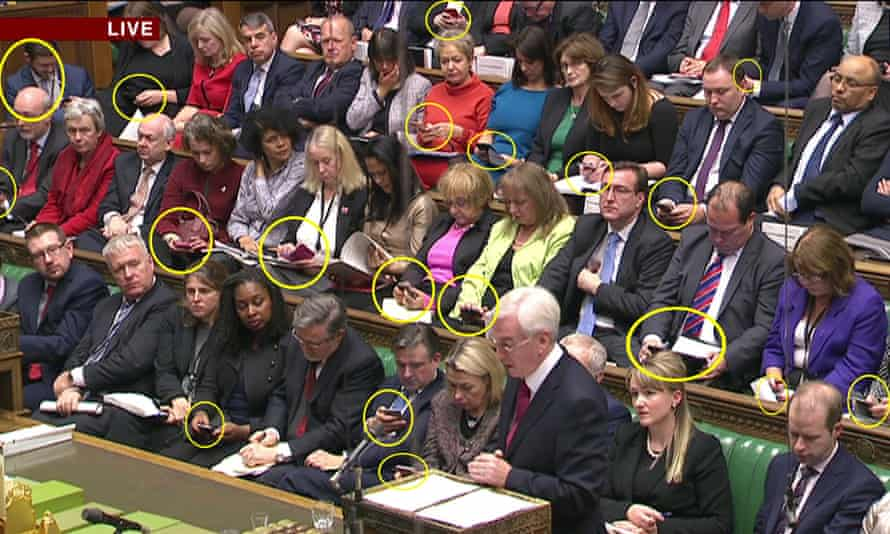 Labour MPs using their smartphones in the House of Commons.
