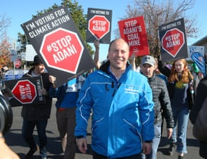 Anti-Adani protesters stalk treasurer Josh Frydenberg as he arrives to vote at a booth in Balwyn for the seat of Kooyong.