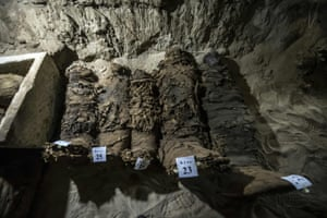 Mummies lying in catacombs following their discovery in the Touna el-Gabal district in central Egypt.