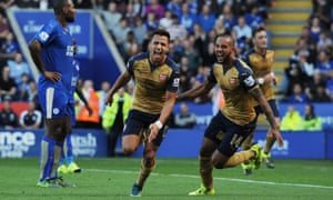 Alexis Sánchez celebrates scoring his first of the season with Theo Walcott as Arsenal found their goalscoring form at Leicester.