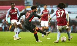 Liverpool's Mohamed Salah fires in their fourth goal.
