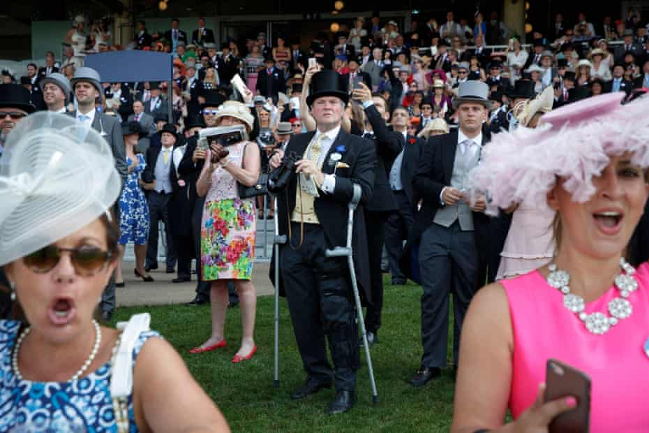 Racegoers watch the finish of the third race in the Royal Enclosure during day two of the Royal Ascot meeting 2017