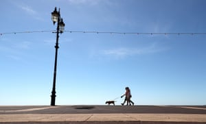 Dog walkers on the Esplanade in Hampshire as sunny weather returns to the UK