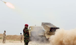 Iraqi soldiers fire a rocket toward Isis militants on the outskirt of Makhmour, south of Mosul.