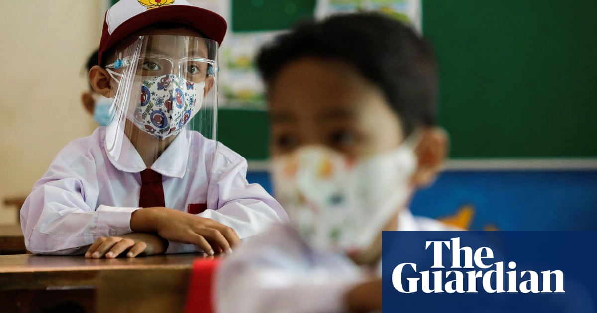 Children return to school in Jakarta as Indonesia eases Covid restrictions
