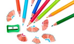 multi-coloured pencils and sharpner