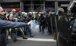 Protesters clash with riot police forces near the Opera Garnier in Paris.