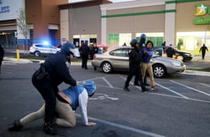 Throughout the evening, police arrest looters