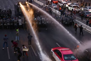 Bangkok, Thailand. A water cannon is deployed by the police to disperse pro-democracy protesters marching toward the residence of prime minister Prayuth Chan-ocha