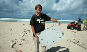 Blaine Alain Gibson displays a piece of debris found on Nosy Boraha island, Madagascar, that could be from the missing plane.