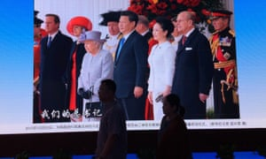 Xi pictured with the Queen in London. One expert believes the president wants to stay in power 'forever'.
