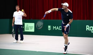 Andy Murray preapres for the Davis Cup as Leon Smith, Great Britain's captain, helps out.
