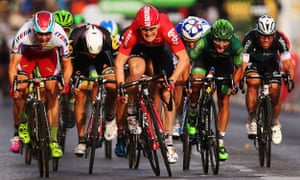 Team Lotto-Soudal's Andre Greipel, centre, eads the bunch sprint to the finish line and win this stage.