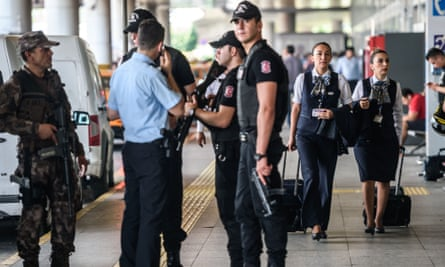 Turkish special force police officers stand guard at Ataturk airport.