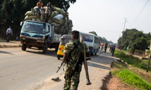 A member of Burundi's military on patrol as police seek weapons in Bujumbura.