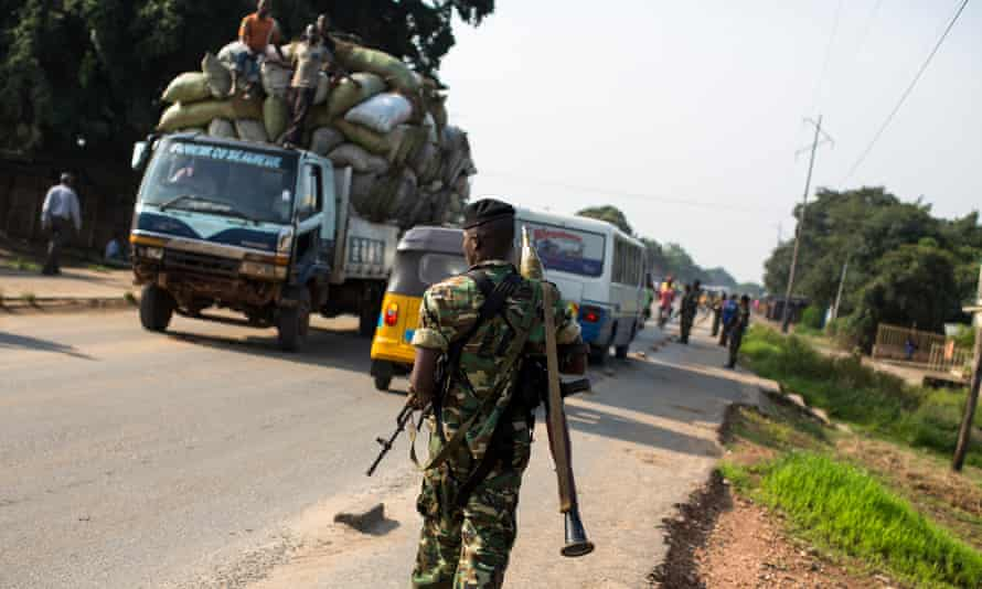 A member of Burundi's military on patrol as police seek weapons in Bujumbura.