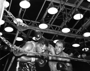 Rocky Marciano, right, throws a right hook against Archie Moore during their fight at Yankee Stadium in New York. Marciano won the World Heavyweight Title by a KO in the ninth.
