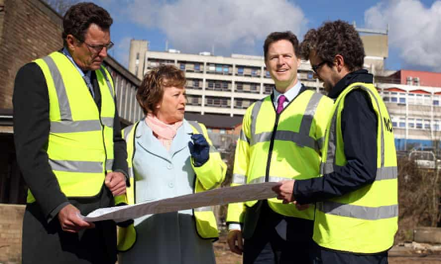 Mayor of Watford Dorothy Thornhill speaks to Nick Clegg and project managers during a visit to the construction site for the Watford Health Campus.