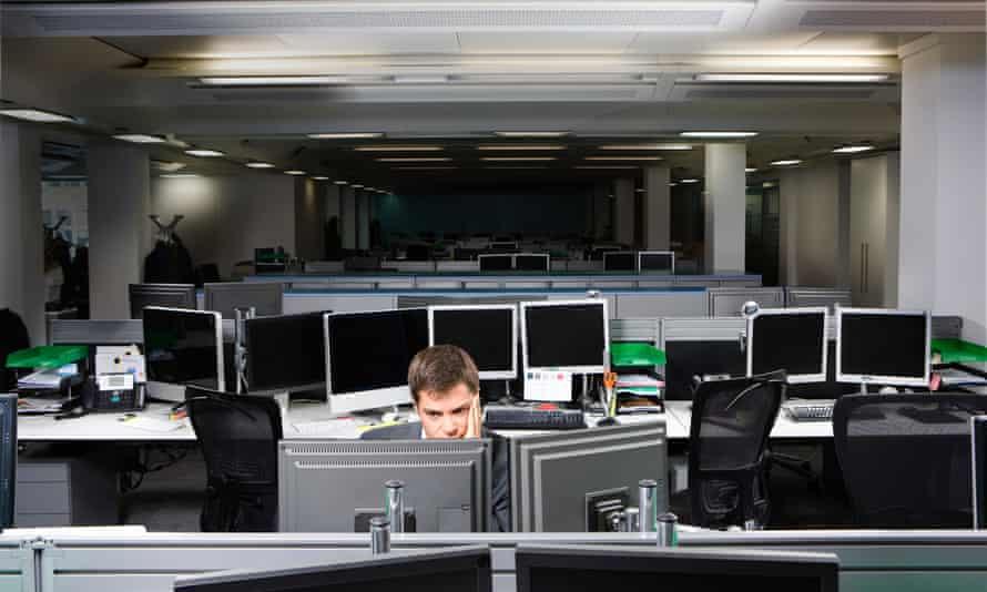 A business man working late<br>Knight Frank, Baker Street, London, UK