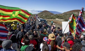 Police confront protesters on the Mauna Kea access road.
