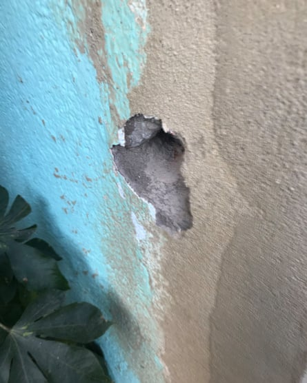 A bullet hole in a wall after a helicopter fired shots in Maré.