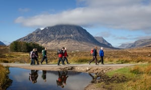 Walkers on the West Highland Way crossing Rannoch Mor close to the head of Glen Coe.