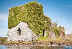 The original 16th-century Ballynahinch castle sits on its own island; Galway, Ireland.