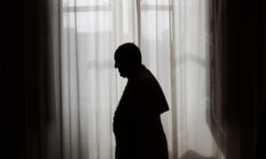 Pope Francis is silhouetted against window light at the end of a meeting at the Vatican.