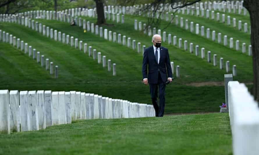 US President Joe Biden walks through Arlington National cemetary to honor fallen veterans of the Afghanistan conflict in Arlington, Virginia on 14 April 2021.