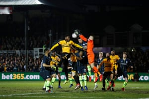 Manchester City keeper Ederson deals with a Newport County cross.