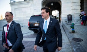 Defense secretary Mark Esper, right, departs after a briefing on developments with Iran at the Capitol on 8 January.