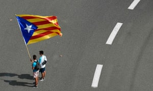 Two men wave a Catalan pro-independence Estelada flag in Barcelona.