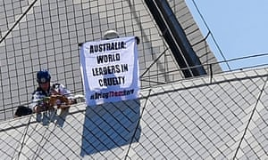 Activists climb the Sydney Opera House to protest against the treatment of refugees on Manus Island.