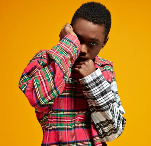 Ashton Sanders, star of Moonlight film, against a yellow background