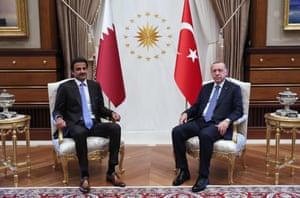 Turkey's President Recep Tayyip Erdogan (R) and the Emir of Qatar Sheikh Tamim bin Hamad Al-Thani posing for a photo prior to their talks in Ankara.