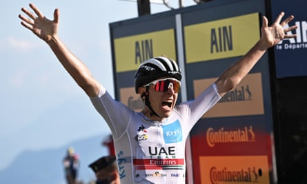 Tadej Pogacar celebrates his win on stage 15 of the Tour de France, on a day when Primoz Roglic tightened his grip on the leader's yellow jersey.