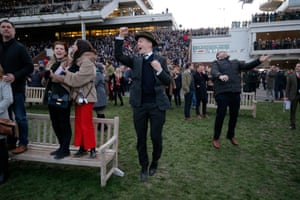 Punters celebrate victory for Envoi Allen in the final race of the day, the Weatherbys Champion Bumper race