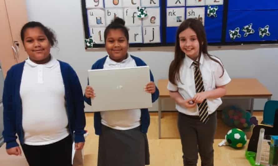 Pupils at Temple Learning Academy with their new laptops. The students aren't told whether their laptop comes from the DfE or Pudsey Computers.