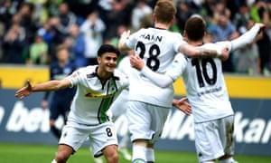 Mönchengladbach midfielder Mahmoud Dahoud, left, celebrates with team-mates Thorgan Hazard (right) and Andre Hahn