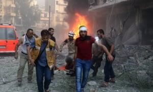 Civilians evacuate a bombing victim in Aleppo