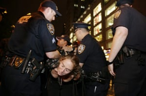 A protester is arrested by two NYPD police Officers