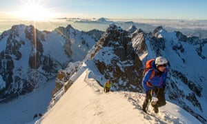 Brooke and Ally arrive on the summit of the Aiguille Verte. Still from Mountain, movie documentary by Jennifer Peedom