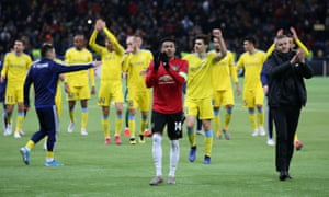 Manchester United manager Ole Gunnar Solskjaer and Jesse Lingard applaud fans after the match.