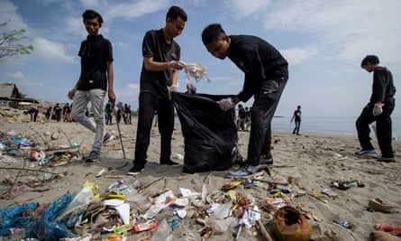 Students cleaning up plastic waste that pollutes the beach in Ujong Blang village, Indonesia.