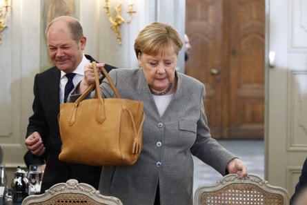 German Cabinet meets in Mesebergepa08005091 German Chancellor Angela Merkel (R) and German Finance Minister and vice Chancellor, Olaf Scholz (L), arrive for a meeting on the second of a two-day government cabinet meeting at the Meseberg palace in Gransee, Germany, 18 November 2019. The German cabinet meets from 17 to 18 November 2019 for a retreat. EPA/Michele Tantussi / POOL